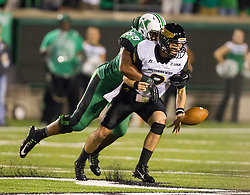Oct 9, 2015; Huntington, WV, USA; Southern Miss Golden Eagles quarterback Nick Mullens fumbles the ball as it was forced out by Marshall Thundering Herd defensive lineman Gary Thompson during the third quarter against the Marshall Thundering Herd at Joan C. Edwards Stadium. Mandatory Credit: Ben Queen-USA TODAY Sports