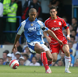 Portsmouth, England: Saturday, April 28, 2007: Liverpool's Mark Gonzalez in action against Portsmouth's Glen Johnson during the Premiership match at Fratton Park (Pic by Chris Ratcliffe/Propaganda)