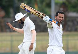 August 6, 2017 - Colombo, Sri Lanka - Sri Lankan cricketer Dimuth Karunaratne(R) celebrates after scoring a century (100 runs) during the 4th Day's play in the 2nd Test match between Sri Lanka and India at the SSC international cricket stadium at the capital city of Colombo, Sri Lanka on Sunday 6 August 2017. (Credit Image: © Tharaka Basnayaka/NurPhoto via ZUMA Press)