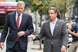 September 18, 2016 - New York, NY, United States - New York State Governor Andre Cuomo and New York City Mayor  (red tie) Bill de Blasio toured the site of the bomb explosion on West 23rd Street between Sixth and Seventh Avenues in Manhattan's Chelsea neighborhood, and then stopped at various local businesses to greet proprietors and residents. (Credit Image: © Albin Lohr-Jones/Pacific Press via ZUMA Wire)