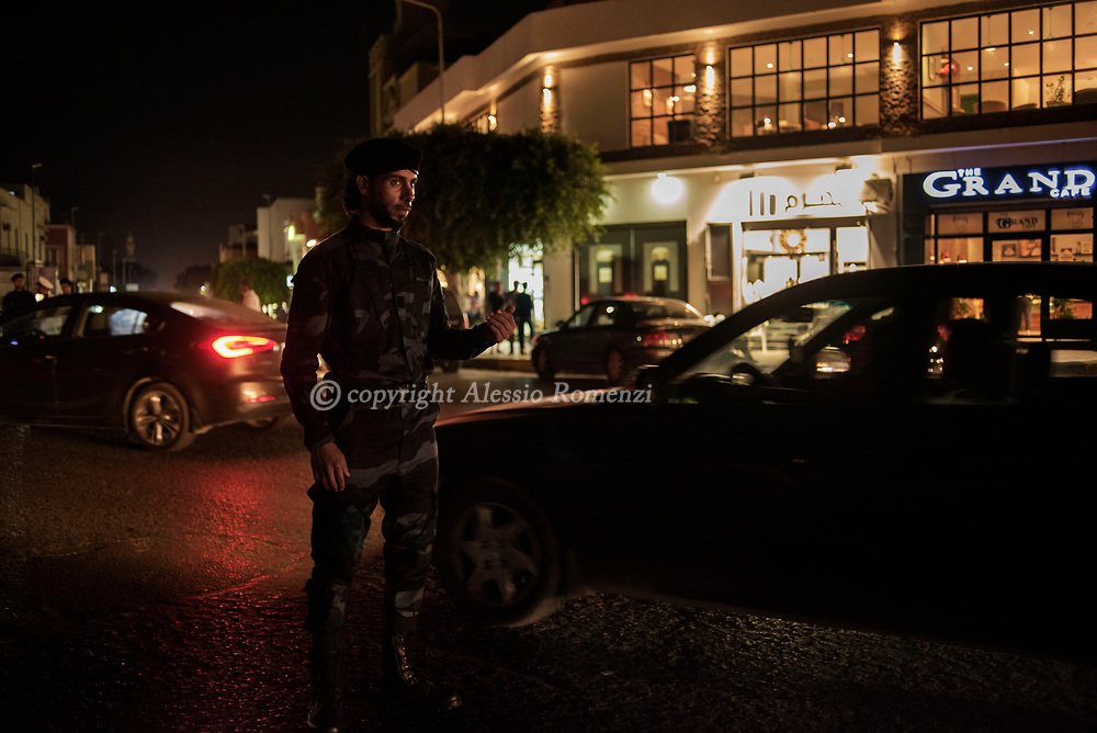 Libya, Tripoli: At night, soldiers check the traffic in a central area in Tripoli. Alessio Romenzi