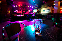 A half empty beer glass sits on a table of a nightclub.  Nanaimo, Vancouver Island, British Columbia, Canada.