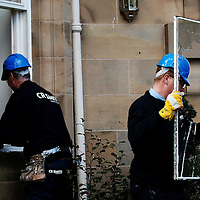 Sir Fred Goodwins house was vandalised overnight with windows being smashed and his car vandalised in Edinburgh...Pic shows a glazier replacing the smashed windows.