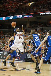 Virginia's Sean Singletary (44) shoots over Duke's DeMarcus Nelson (21).  The University of Virginia Cavaliers beat the #8 ranked Duke University Blue Devils 68-66 in overtime at the John Paul Jones Arena in Charlottesville, VA on February 1, 2007...