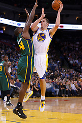 Feb 2, 2012; Oakland, CA, USA; Golden State Warriors power forward David Lee (10) shoots over Utah Jazz power forward Paul Millsap (24) during the first quarter at Oracle Arena. Mandatory Credit: Jason O. Watson-US PRESSWIRE