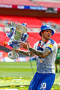PROMOTION promoted Tranmere Rovers midfielder James Norwood (10) holds the trophy aloft after the EFL Sky Bet League 2 Play Off Final match between Newport County and Tranmere Rovers at Wembley Stadium, London, England on 25 May 2019.