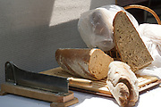 loaves of Bread on a breadboard with a bread knife