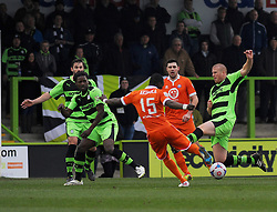 Forest Green Rovers's Charlie Clough blocks a shot by Braintree Town's Simeon Akinola  - Photo mandatory by-line: Nizaam Jones - Mobile: 07966 386802 - 14/03/2015 - SPORT - Football - Nailsworth - The New Lawn - Forest Green Rovers v Braintree  - Vanarama Football Conference.