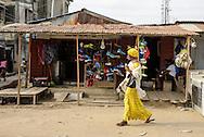 Woman walking in Lekki, Lagos, Nigeria, West Africa