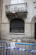 "Police tape surrounding damaged balcony, Rue Vanderkindere, Brussels. This balconay has been ""collapsing"" for months now. There was some pallets around it, warn off people from walking under it. Then it got a sudden upgrade to police tape, and an advertisement for bouncy castles. N'importe quoi."