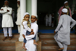 June 16, 2018 - Kathmandu, Nepal - A Nepalese Muslim boy carries his brother after prayers during Eid al-Fitr festival at Jame Mosque in Kathmandu, Nepal on Saturday, June 16, 2018. (Credit Image: © Skanda Gautam via ZUMA Wire)
