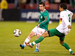 February 24, 2010; San Francisco, CA, USA;  Mexico midfielder Luis Miguel Noriega (13) pass the ball around Bolivia midfielder Walter Velzaga (8) during the second half at Candlestick Park. Mexico defeated Bolivia 5-0.