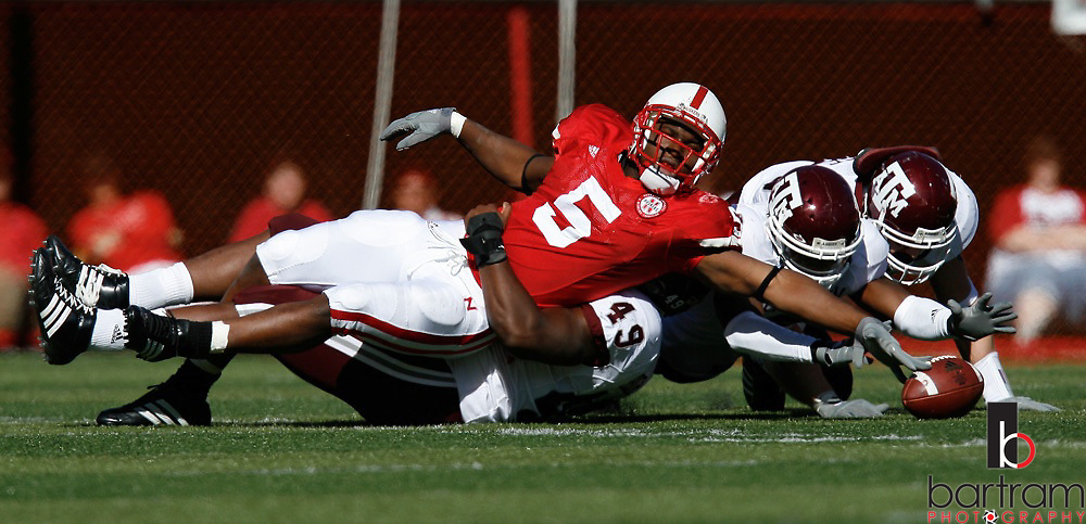 Nebraska running back Marlon Lucky loses the ball as he is tackled by Texas a&M defensive lineman Cyril Obiozor on Saturday, Oct. 20, 2007.