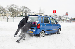 © Licensed to London News Pictures. 02/03/2018. Cardiff, UK.  A car being pushed form though snow as Storm Emma leaves drifts and stranded cars in Cardiff, Wales. Photo credit: Ian Holmer/LNP