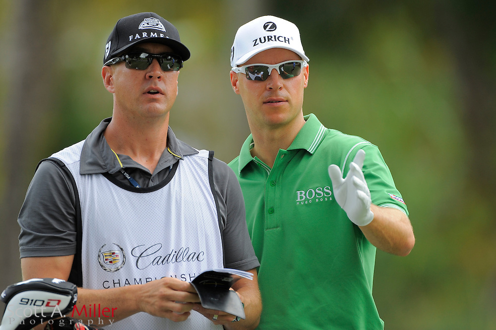 Ben Crane and his caddie during the first round of the World Golf Championship Cadillac Championship on the TPC Blue Monster Course at Doral Golf Resort And Spa on March 8, 2012 in Doral, Fla. ..©2012 Scott A. Miller.