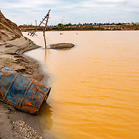 Sluices, shelters, and other infrastructure destroyed by the military are part of the aftermath of illegal and unofficial alluvial gold mining after miners were forcobly removed from the area, showing local pollution and the massive deforestation associated with the process. Following Peru's February 2019 militarized crackdown on illegal and unofficial alluvial gold mining in the La Pampa region of Madre de Dios, Wake Forest University's Puerto Maldonado-based Centro de Innovación Científica Amazonia (CINCIA), a leading research institution for the development of technological innovation for biological conservation and environmental restoration in the Peruvian Amazon, is applying years of scientific research and technical experience related to understanding mercury contamination and managing Amazonian ecosystems. What they learn will help guide urgent remediation, restoration, and reforestation efforts that can also serve as models for how we address the tropic's most dramatically devastated landscapes around the world. La Pampa, Madre de Dios, Peru.