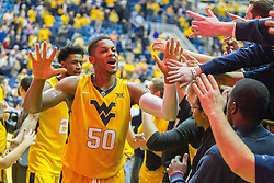 Jan 24, 2017; Morgantown, WV, USA; West Virginia Mountaineers forward Sagaba Konate (50) celebrates with fans after beating the Kansas Jayhawks at WVU Coliseum. Mandatory Credit: Ben Queen-USA TODAY Sports