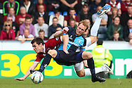 Stuart Lewis of Wycombe Wanderers (front) and John Marquis of Northampton Town battle it out during the Sky Bet League 2 match at Adams Park, High Wycombe<br /> Picture by David Horn/Focus Images Ltd +44 7545 970036<br /> 18/04/2014