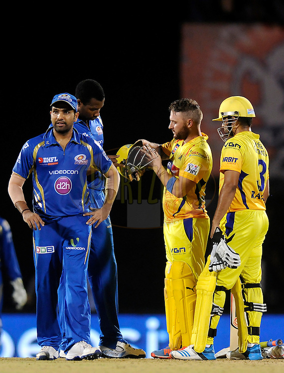 Kieron Pollard of the Mumbai Indians checks the helmet of Brendon McCullum of The Chennai Superkings as the latter gets hit by a ball bowled by Corey Anderson of the Mumbai Indians during the eliminator match of the Pepsi Indian Premier League Season 2014 between the Chennai Superkings and the Mumbai Indians held at the Brabourne Stadium, Mumbai, India on the 28th May  2014<br /> <br /> Photo by Pal PIllai / IPL / SPORTZPICS<br /> <br /> <br /> <br /> Image use subject to terms and conditions which can be found here:  http://sportzpics.photoshelter.com/gallery/Pepsi-IPL-Image-terms-and-conditions/G00004VW1IVJ.gB0/C0000TScjhBM6ikg