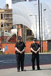 May 25, 2017 - Manchester, United Kingdom - Image licensed to i-Images Picture Agency. 25/05/2017. Manchester , United Kingdom. Police observe a one minutes silence for the victims of the Manchester terror attack near the scene of the atrocity at the Manchester Arena  . Picture by Stephen Lock / i-Images (Credit Image: © Stephen Lock/i-Images via ZUMA Press)