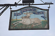 The White Hart pub sign at the village of Nayland, Essex, England