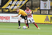 Brad Halliday and Jacob Maddox  during the EFL Sky Bet League 2 match between Cambridge United and Cheltenham Town at the Cambs Glass Stadium, Cambridge, England on 25 August 2018.