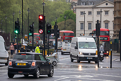 © Licensed to London News Pictures. 28/04/2020. London, UK. Traffic on Parliament Square in Westminster today. London has also seen an increase in traffic and busier High Streets as more shops and cafes start to open up during the coronavirus pandemic crisis. Photo credit: Alex Lentati/LNP