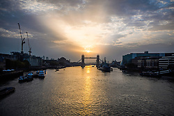 © Licensed to London News Pictures. 16/10/2017. London, UK. Sunrise at Tower Bridge in London as the remnants of Hurricane Ophelia heads for the British Isles. Winds of up to 80mph are expected in some parts of the UK. Photo credit: Ben Cawthra/LNP