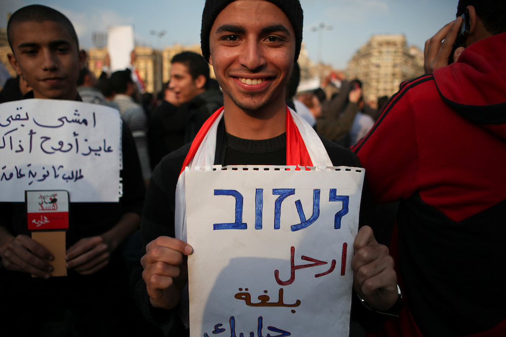 """Protests calling for the ouster of President Hosni Mubarak continued at Tahrir Square on 8 February. Protesters joked that Mubarak doesn't understand calls for him to leave in Arabic, so a pro-democracy protester carries a sign calling on Mubarak to """"leave"""" in Hebrew."""