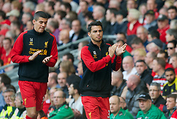 LIVERPOOL, ENGLAND - Sunday, May 19, 2013: Liverpool's substitutes 'Suso' Jesus Joaquin Fernandez Saenz De La Torre and Conor Coady warm-up during the final Premiership match of the 2012/13 season against Queens Park Rangers at Anfield. (Pic by David Rawcliffe/Propaganda)