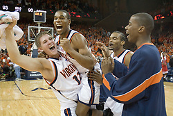 Virginia's Lars Mikalauskas and Sean Singeltary celebrate as UVA defeated the #10 ranked Wildcats 93-90 in the first game at the new John Paul Jones Arena, in Charlottesville, VA on November 12, 2006...