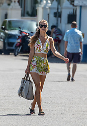 © Licensed to London News Pictures. 07/08/2020. London, UK. A young women enjoys the sunshine at Putney Embankment in South West London as temperatures are expected to reach to 35c today. Thousands of sun seekers have flocked to parks, rivers and the south coast as temperatures soar with beaches and roads becoming jammed with holidaymakers. The heat is set to continue for the rest of the week with temperatures expected in the high 20s. Photo credit: Alex Lentati/LNP