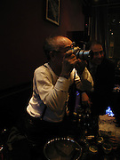 Nobuyoshi Araki , Party given for Nobuyoshi Araki by White Cube after the opening of his Self´Life´Death exhibition at the Barbican. Zyrus/Genesys Karaoke bar. Clerkenwell Rd. London. 5 October 2005. . ONE TIME USE ONLY - DO NOT ARCHIVE © Copyright Photograph by Dafydd Jones 66 Stockwell Park Rd. London SW9 0DA Tel 020 7733 0108 www.dafjones.com