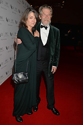 JOHN HURT and his wife ANWEN REES-MYERS at the IWC Schaffhausen Gala Dinner in honour of the British Film Institute held at the Battersea Evolution, Battersea Park, London on 7th October 2014.