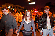 "Oct. 30, 2009 -- PHOENIX, AZ: Zombies cross a street in Phoenix Friday during the Zombie Walk. About 200 people participated in the first ""Zombie Walk"" in Phoenix, AZ, Friday night. The Zombies walked through downtown Phoenix ""attacking"" willing victims and mixing with folks going to the theatre and downtown sports venues.  Photo by Jack Kurtz"