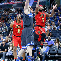 25 February 2017: Atlanta Hawks guard Malcolm Delaney (5) goes for the jump shot overt Orlando Magic center Nikola Vucevic (9) during the Orlando Magic 105-86 victory over the Atlanta Hawks, at the Amway Center, Orlando, Florida, USA.