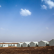 The camp is designed with six villages, three of which have been built. Village Five is ready for refugees, with Village Three in the background, currently the only village with residents. Azraq camp for Syrian refugees, Jordan, May 2015.