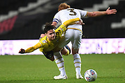 Coventry City midfielder (on loan from Aston Villa) Callum O'Hare (17)  is fouled by Milton Keynes Dons defender Dean Lewington (3) during the EFL Trophy match between Milton Keynes Dons and Coventry City at Stadium:MK, Milton Keynes, England on 3 December 2019.
