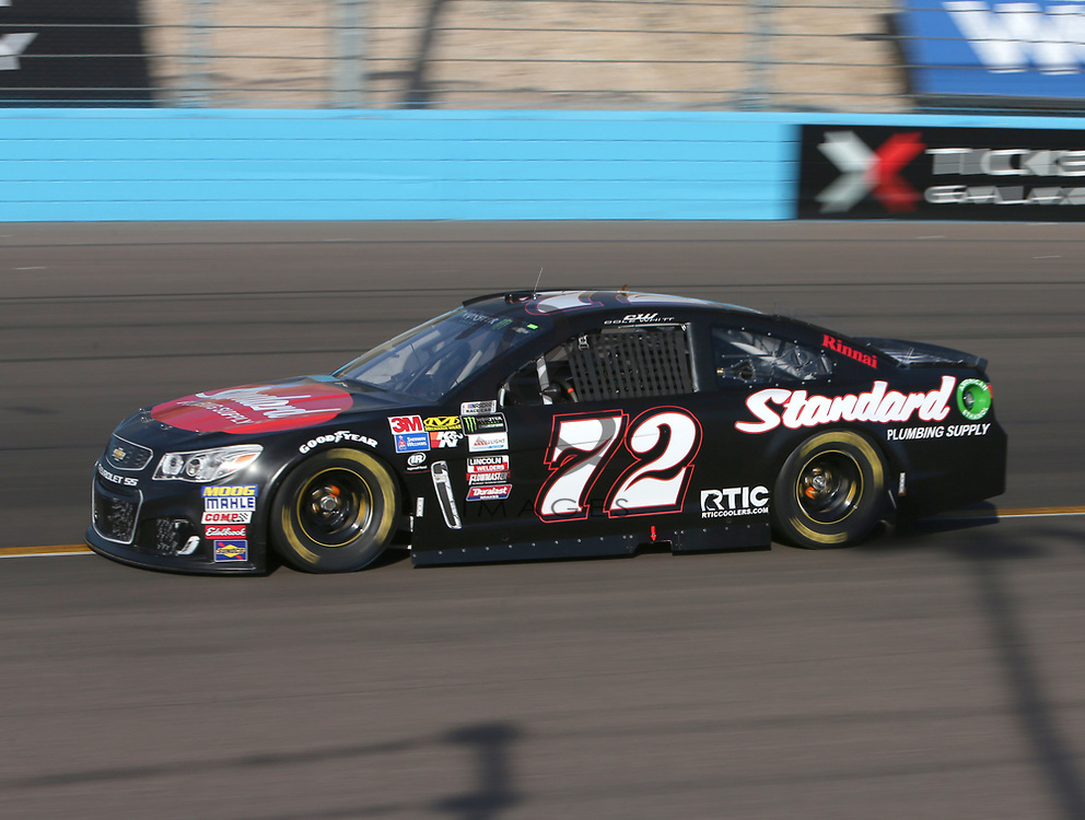 Cole Whitt qualifies for Sunday's NASCAR Cup Series auto race on Friday, March 17, 2017, in Avondale, Ariz.  (AP Photo/Rick Scuteri)