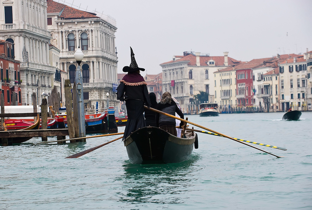 VENICE, ITALY - JANUARY 06:  A venetian boat heads to the Befana Regata with rowers dressed in costumes of on January 6, 2011 in Venice, Italy.  In Italian folklore, Befana is an old woman who delivers gifts to children throughout Italy on Epiphany January 6 iin a similar way to Saint Nicholas or Santa Claus
