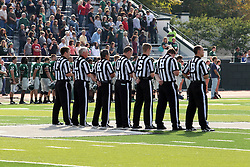 12 October 2013:  Officials line up for the National Anthem (l-r) Brad Carrell, Chet Lien, Dave Wallace, Mike Renner, Dave Dupre, John Cameron, and Phil Kaufman during an NCAA division 3 football game between the North Park vikings and the Illinois Wesleyan Titans in Tucci Stadium on Wilder Field, Bloomington IL