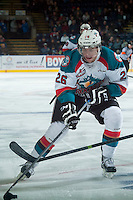 KELOWNA, CANADA - JANUARY 3: Cole Linaker #26 of Kelowna Rockets skates with the puck against the Prince George Cougars on January 3, 2015 at Prospera Place in Kelowna, British Columbia, Canada.  (Photo by Marissa Baecker/Shoot the Breeze)  *** Local Caption *** Cole Linaker;