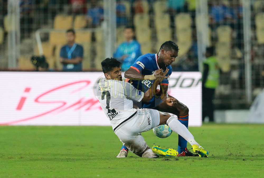 Rahul Bheke of FC Pune City and Fulganco Cardoza of FC Goa in action  during match 8 of the Indian Super League (ISL) season 3 between FC Goa and FC Pune City held at the Fatorda Stadium in Goa, India on the 8th October 2016.<br /> <br /> Photo by Vipin Pawar / ISL/ SPORTZPICS