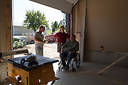 21 September 2012-Budge Porter Project   .ex-husker, paralyzed  building handicap accessible dream home for him. Group effort of construction leaders, Kent Pavelka, Tom Osborne..Fundraiser Aug. 15.Contact Brad Brown, Archistructure.