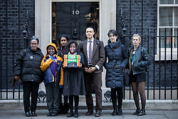 "© Licensed to London News Pictures. 29/11/2016. London, UK. Yemi Hailemariam, Yilak Andargachew, Helawit Hailemariam, Menabe Andargachew, Clive Lewis MP, Dame Harriet Walter and Sara Pascoe [Left to Right] bring a petition to Downing Street calling on the Prime Minister to seek the release of British man Andargachew ""Andy"" Tsege, who is in his sixties, who is in prison in Ethiopia under the shadow of a death sentence. Andargachew Tsegehas been detained in the country since he was removed from an airport in Yemen in June 2014. The father-of-three, who fled the country in the 1970s and sought asylum in the UK in 1979, had been a prominent critic of Ethiopia's ruling party. Photo credit : Tom Nicholson/LNP"