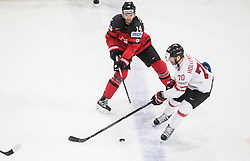Sean Couturier of Canada vs Denis Hollenstein of Switzerland during the 2017 IIHF Men's World Championship group B Ice hockey match between National Teams of Canada and Switzerland, on May 13, 2017 in AccorHotels Arena in Paris, France. Photo by Vid Ponikvar / Sportida