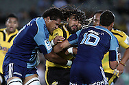 Hurricanes' Ma'a Nonu smashes into Blues' Peter Saili and Stephen Brett. Super 15 rugby union match, Blues v Hurricanes at Eden Park, Auckland, New Zealand. Saturday 19th March 2011. Photo: Anthony Au-Yeung / photosport.co.nz