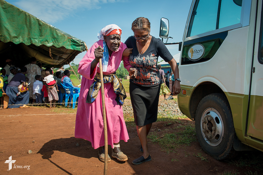 Shara Cunningham, a career missionary of The Lutheran Church—Missouri Synod in Kenya, East Africa, assists a woman to a van for transport to the hospital during the Mercy Medical Team Thursday, June 12, 2014, at the Luanda Doho Primary School in Kakmega County, Kenya. LCMS Communications/Erik M. Lunsford