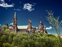 The Parliament Hill Building over dramatic deep blue sky, springtime day scemery. Ottawa, Ontario, Canada May 2017.
