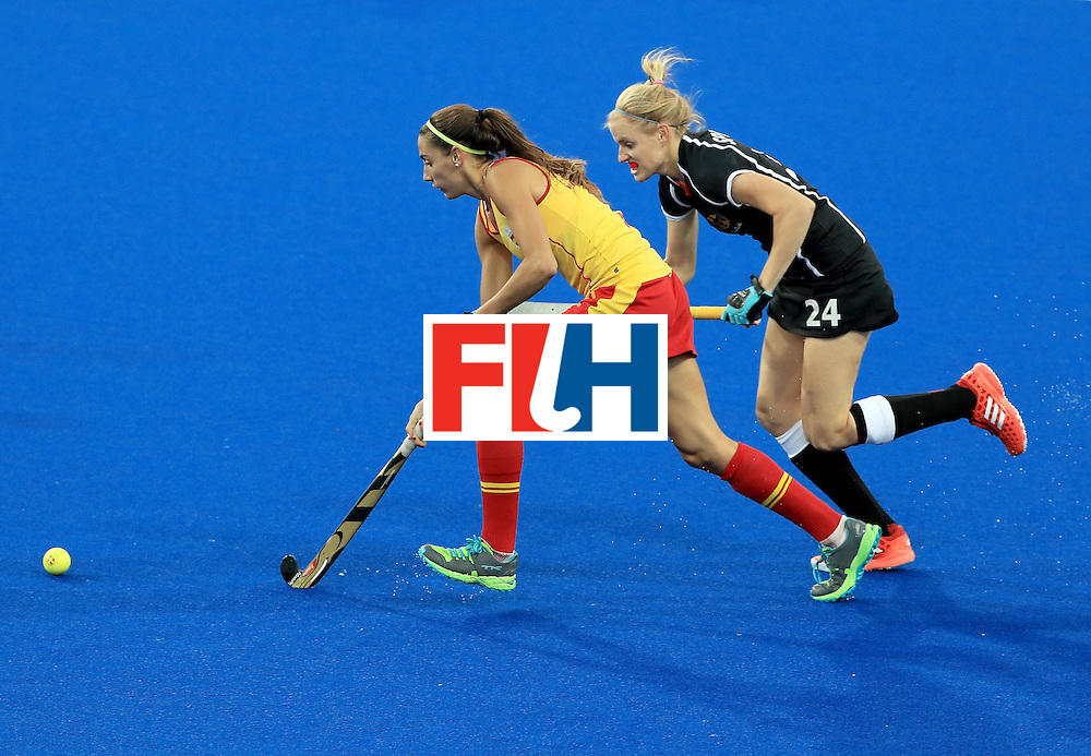 RIO DE JANEIRO, BRAZIL - AUGUST 11:  Annika Sprink #24 of Germany defends against Carola Salvatella #8 of Spain during a Women's Preliminary Pool A match at the Olympic Hockey Centre on August 11, 2016 in Rio de Janeiro, Brazil.  (Photo by Sam Greenwood/Getty Images)